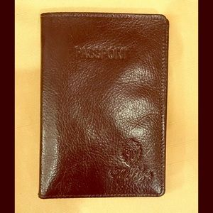 Brown leather passport and card holder The Plaza.